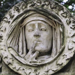 The finger to the lips in this funerary sculpture signifies respect and silence
