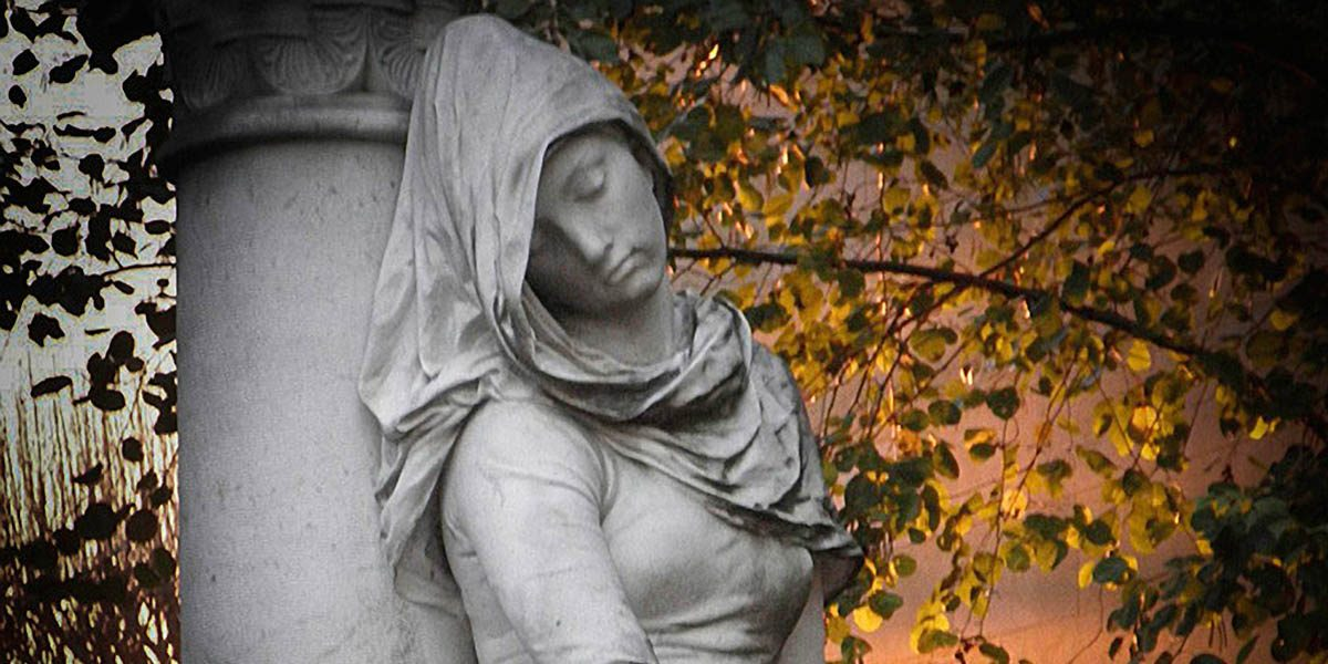 Sculpture of mourning woman at Père Lachaise