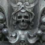 Skull carving on tomb